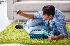 The young man getting rabbit as birthday present. Young man getting rabbit as birthday present Royalty Free Stock Image