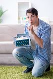 The young man getting rabbit as birthday present. Young man getting rabbit as birthday present Stock Images