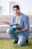 The young man getting rabbit as birthday present Royalty Free Stock Photo
