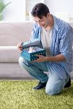 The young man getting rabbit as birthday present. Young man getting rabbit as birthday present Stock Photo