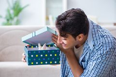 The young man getting rabbit as birthday present. Young man getting rabbit as birthday present Stock Image