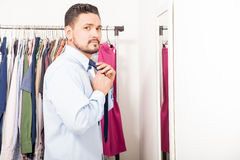 Young man getting ready in a dressing room Stock Photography