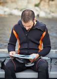 Young man getting ready for scuba diving royalty free stock photos