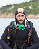 Young man getting ready for scuba diving Royalty Free Stock Image