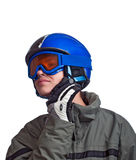 Young man getting ready to ski. Teenage boy checking his helmet strap before heading down the slope Stock Images