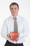 Young Man With A Gift Royalty Free Stock Photos