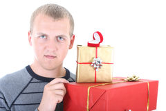 Young man with gifts Royalty Free Stock Photo