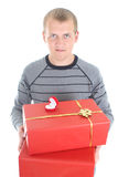 Young man with gifts Royalty Free Stock Image