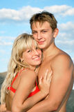 Young man and girl. On seacoast Stock Image