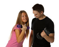 Young man and the girl with dumbbells Stock Photos