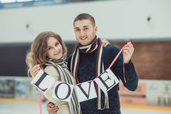 Young man and girl holding LOVE letters in their Royalty Free Stock Photo