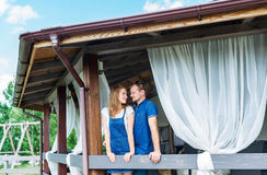 A young man and a girl in the interior. Lovers embrace, kiss, spend time together. Royalty Free Stock Photos