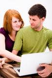 Young man and girl with laptop computer Royalty Free Stock Image
