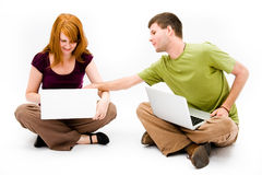 Young man and girl with laptop computer Stock Photo