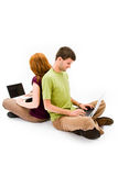 Young man and girl with laptop computer Stock Photos