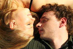Young man and girl lies Royalty Free Stock Photography