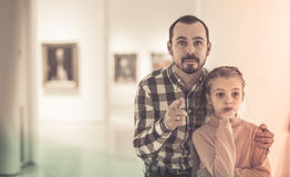 Young man and girl looking paintings in museum Royalty Free Stock Photography