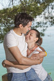 Young man and girl necking Stock Images