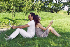 Young man and girl in the park Royalty Free Stock Photo