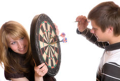 The young man and girl play a darts Stock Photography