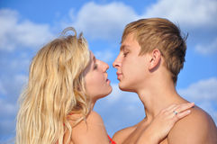 Young man and girl seacoast Royalty Free Stock Photography