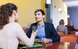 Young man and girlfriend chatting as having date Stock Photography