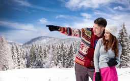 Young man with girlfriend on winter day Royalty Free Stock Photo