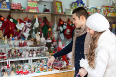 Young man with girlfriend at  X-mas market Stock Photos