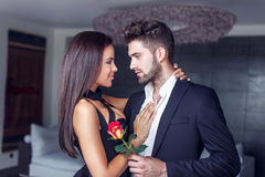 Young man give rose to lover indoor Stock Photography