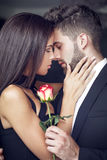 Young man give rose to lover indoor Royalty Free Stock Photos