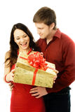 Young man giver a present to his wife. Happy young couple, a man gives a present to his wife Stock Photos