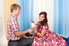 The young man gives a beautiful woman flowers Stock Images