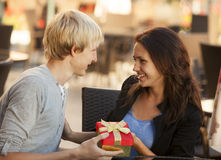 The young man gives a gift Royalty Free Stock Photo