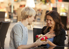 The young man gives a gift Royalty Free Stock Images