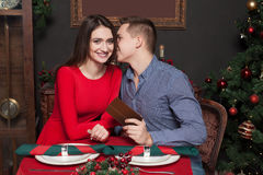 Young man gives a gift to beautiful woman Royalty Free Stock Photo