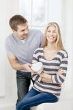 Young man gives a gift to a girl Royalty Free Stock Images