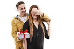 Young man gives gift, valentines day Royalty Free Stock Photo