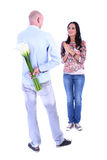 The young man gives his girlfriend bouquet of callas. The young men gives his girlfriend bouquet of callas on Valentine's Day isolated Royalty Free Stock Photos