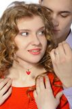 Young man gives his girlfriend a pendant Royalty Free Stock Photo