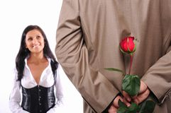 Young man gives his girlfriend a rose Stock Photography