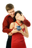 Young man gives a present to his wife Stock Photos