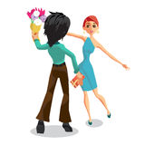 The young man gives a woman a bouquet of flowers Stock Images