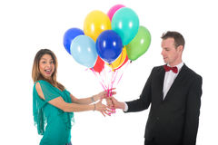 Young man giving balloons to girl friend Stock Photo