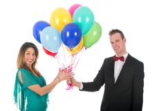 Young man giving balloons to girl friend Royalty Free Stock Image