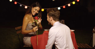 Young man giving a beautiful woman  rose Stock Photography