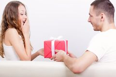 Young man giving box  for his girlfriend Royalty Free Stock Photography