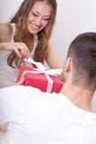 Young man giving box  for his girlfriend Stock Photo