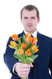 Young man giving bunch of tulips Royalty Free Stock Photography