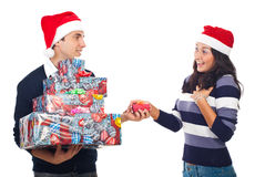 Young man  giving Christmas gift to a woman Stock Image