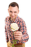 Young man giving a flower. Stock Photography